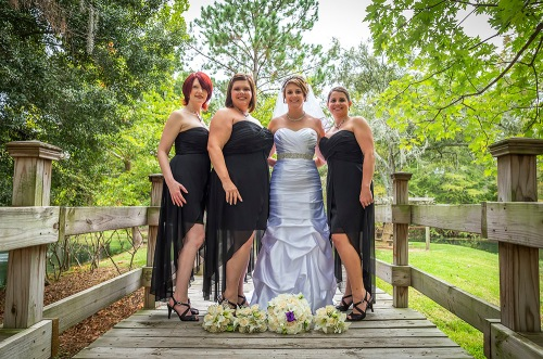 Bride and Bridesmaids On The Bridge