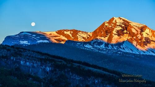 Moonset And Sunrises Over Heavens Peak