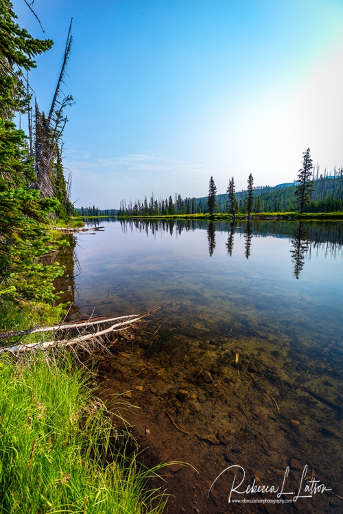 A Quiet Glassy Lake In Yellowstone