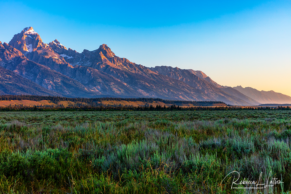 Sunrise Over The Grand Teton Mountains