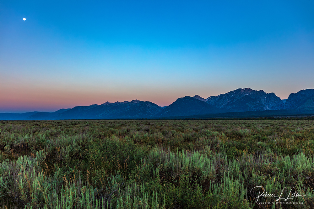 Full Moon And The Beginning Of Sunrise Over The Tetons