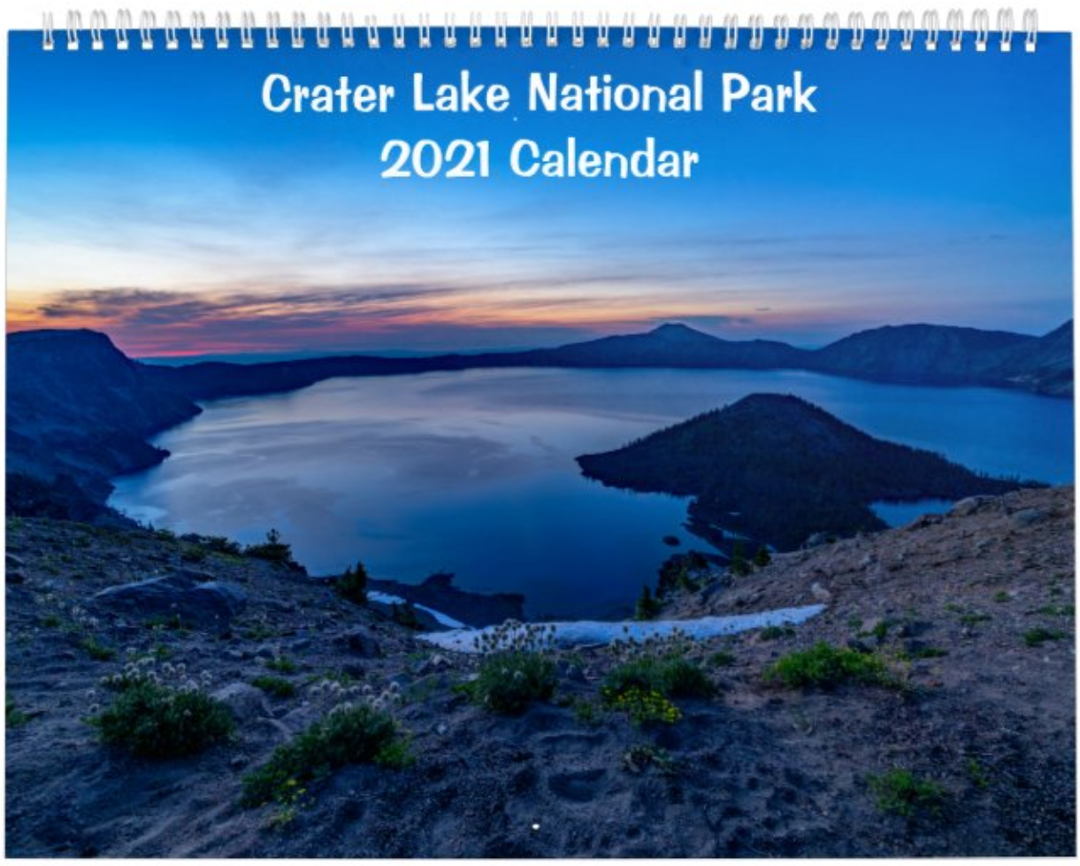 A 12-month 2021 wall calendar featuring stunning images taken during a visit to Crater Lake National Park in Oregon